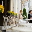 Bride and groom at outdoor cafe — Stock Photo #13725100