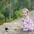 Adorable toddler girl in a floral dress — Stock Photo #13725121