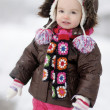 Adorable toddler girl having fun at winter — Stock Photo