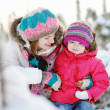 Young mother and her daughter at winter — Stockfoto