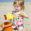 Cute little girl playing with beach toys - Stock Photo