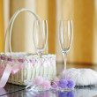 A pair of wedding glasses, basket and a ring pillow — Stock Photo #13725302
