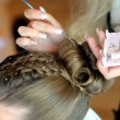 Stock Photo: Woman's hands making hairstyle