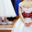 Stock Photo: Beautiful bow on flower-girl's dress