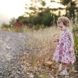 Adorable toddler girl in a floral dress — Stock Photo #13725379
