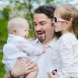Young father and his two daughters - Stock Photo