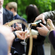 Pouring champagne into a glass — Stock Photo