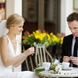 Bride and groom at outdoor cafe — Stock Photo #13725795