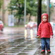 Adorable toddler girl at rainy day in autumn — Stock Photo #13725906