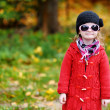 Adorable little girl on autumn day — Stock Photo #13725923
