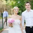 Bride and groom having a walk — Stock Photo #13725945