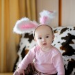 Little baby girl with pink bunny ears — Stock Photo