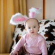 Little baby girl with pink bunny ears - Foto Stock