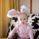 Little baby girl with pink bunny ears — Stock Photo
