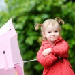 Adorable girl at rainy day in autumn — Stock Photo