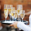 Stock Photo: Waiter serving champagne