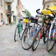 Stock Photo: Row of parked colorful bikes