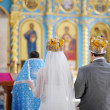 Bride and groom in an orthodox church — Stock Photo