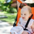 Little girl in a stroller - Stock Photo