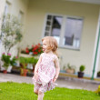 Adorable little girl in a yard — Photo