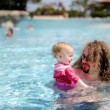 Royalty-Free Stock Photo: Young father and his baby girl in a pool