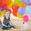 Little birthday girl with tons of balloons — Stock Photo #13726399