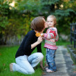 Young mother and her toddler girl in autumn — Stock Photo #13726403