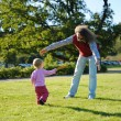 Young dad and his little daughter playing frisbee — Stock Photo #13726414