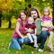 Family of four at autumn — Stock Photo