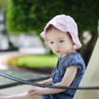 LIttle girl in pink hat — Stock Photo