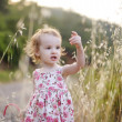 Adorable toddler girl in a floral dress — Stock Photo #13726505