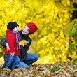 Stock Photo: Young mother and her toddler girl in autumn