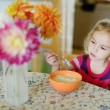 Royalty-Free Stock Photo: Little girl with a spoon of porridge