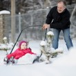 Winter fun: having a ride on a snow shovel — Stock Photo