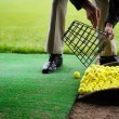 Golf balls pouring out of basket — Stock Photo