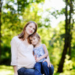 Pregnant mother with her small daughter — Stock Photo