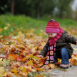 Little baby in an autumn park — Stock Photo