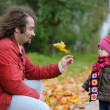 Young father and his baby in autumn park — Stock Photo #13726929