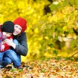 Young mother and her toddler girl in autumn — Stok fotoğraf