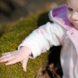 Little baby girl sitting in a spring forest — Stock Photo #13727025