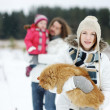 Happy family and a cat on a winter day — Stock Photo