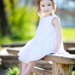 Adorable preschooler girl portrait outdoors — Stock Photo #13727037