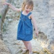 Little girl playing in a creek — Stock Photo #13727053