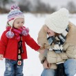 Little winter baby girl and her young mother — Stock Photo #13727058