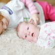 Little girl and her newborn sister — Stock Photo #13727135