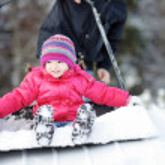 Winter fun: having a ride on a snow shovel — Stock Photo