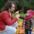 Father and his baby girl in an autumn park — Stock Photo #13727145