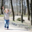 Adorable toddler girl jumping outdoors — Stock Photo