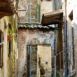 Stock Photo: Narrow Italian street in Pitigliano