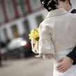 Groom girdling bride's waist — Stock Photo